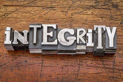 integrity word in vintage metal type printing blocks over grunge
